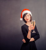 Cute woman in santa hat with drink Royalty Free Stock Image