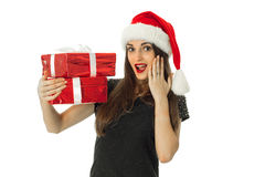 Cute Woman in santa hat with red gift Royalty Free Stock Photos