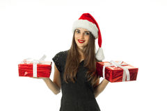 Cute woman in santa hat smiling Royalty Free Stock Photography
