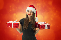 Cute woman in santa hat smiling Stock Photography
