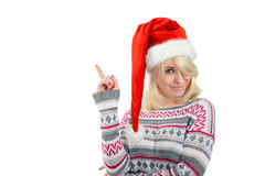 A cute woman in Santa's hat pointing up with finger Stock Images