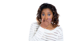 A cute woman in shock placing hand on mouth Royalty Free Stock Photography