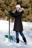 Cute Woman shoveling snow Royalty Free Stock Photo