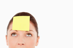 Cute woman with a sign on her forehead Royalty Free Stock Photo
