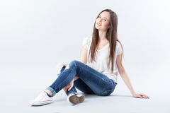 Cute woman sitting on the floor and smiling. Woman sitting on the floor and smiling Royalty Free Stock Images