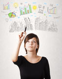 Cute woman sketching city and graph icons Royalty Free Stock Photo