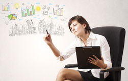 Cute woman sketching city and graph icons Royalty Free Stock Photography