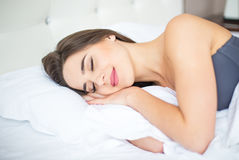The cute woman sleeping on the bed at home Royalty Free Stock Image