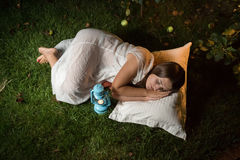 Cute woman sleeping in garden at night Royalty Free Stock Photo