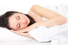 Cute woman sleeps on the bed Stock Image