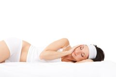 Cute woman sleeps on the bed Stock Photography