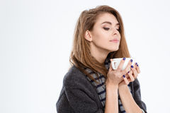 Cute woman smelling cup with coffee Royalty Free Stock Images