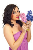 Cute woman smelling hyacinth Stock Image