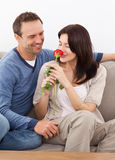 Cute woman smelling a red rose Stock Images