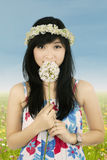 Cute woman smelling spring flower stock photo