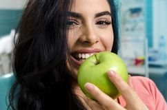 Cute, woman smiling and biting apple stock image