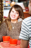 Cute Woman Smiling at Friend Royalty Free Stock Images