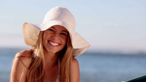 Cute woman smiling while she is on a hammock stock video footage