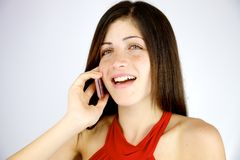 Cute woman smiling on the phone happy Royalty Free Stock Photos