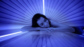 Cute woman in solarium Royalty Free Stock Photo
