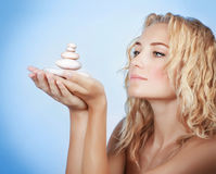 Cute woman with spa stones Royalty Free Stock Images