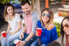 Cute woman spending time with some friends. Beautiful young women drinking beer with her friends at a game and having some fun stock photography
