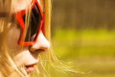 Cute woman in star-shaped sun glasses Stock Image