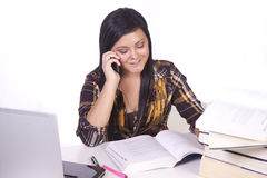 Cute Woman Studying at her Desk Stock Photography
