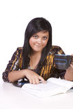 Cute Woman Studying at her Desk Royalty Free Stock Photography