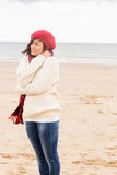 Cute woman in stylish warm clothing at beach Royalty Free Stock Photo