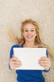 Cute woman with tablet Royalty Free Stock Images