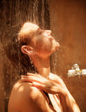 Cute woman take shower. Outdoors, people hygiene, enjoying clear cold water, day spa, purity conception Stock Photography