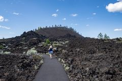 Free Cute Woman Takes A Hike Along The Trail Of Molten Lands In Lava Lands Newberry Volcano National Monument In Oregon Royalty Free Stock Photography - 154840397
