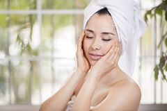 Cute woman taking care of her skin Royalty Free Stock Photos