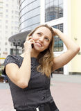 Cute woman talking by telephone Stock Photo