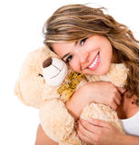 Cute woman with a teddy bear Stock Photos