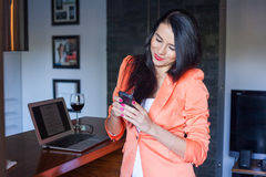 Cute woman texting at home. Stock Image