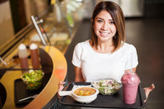 Cute woman with a tray of healthy food Royalty Free Stock Images