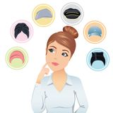 Cute woman trying to choose a hat. Royalty Free Stock Photos