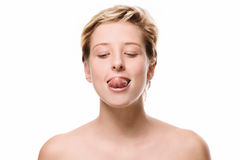 Cute woman trying to reach her nose with her tongue Royalty Free Stock Photos