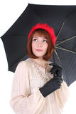 Cute woman with umbrella dreaming Stock Images