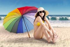 Cute woman with umbrella at shore Royalty Free Stock Photos