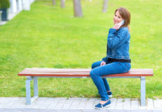 Cute woman use a cell phone Royalty Free Stock Image