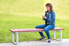 Cute woman use a cell phone Stock Photo