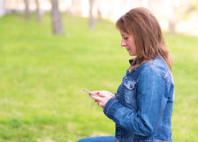 Cute woman use a cell phone Royalty Free Stock Photo