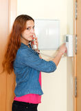 Cute woman using house videophone indoor Stock Photography
