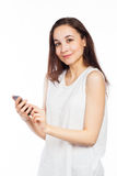 Cute woman using a smartphone Royalty Free Stock Photography