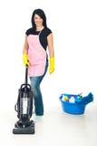 Cute woman using vacuum cleaner royalty free stock image