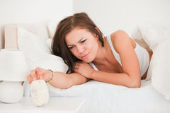 Cute woman waking up Royalty Free Stock Photos