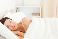 Cute woman waking up Royalty Free Stock Photography